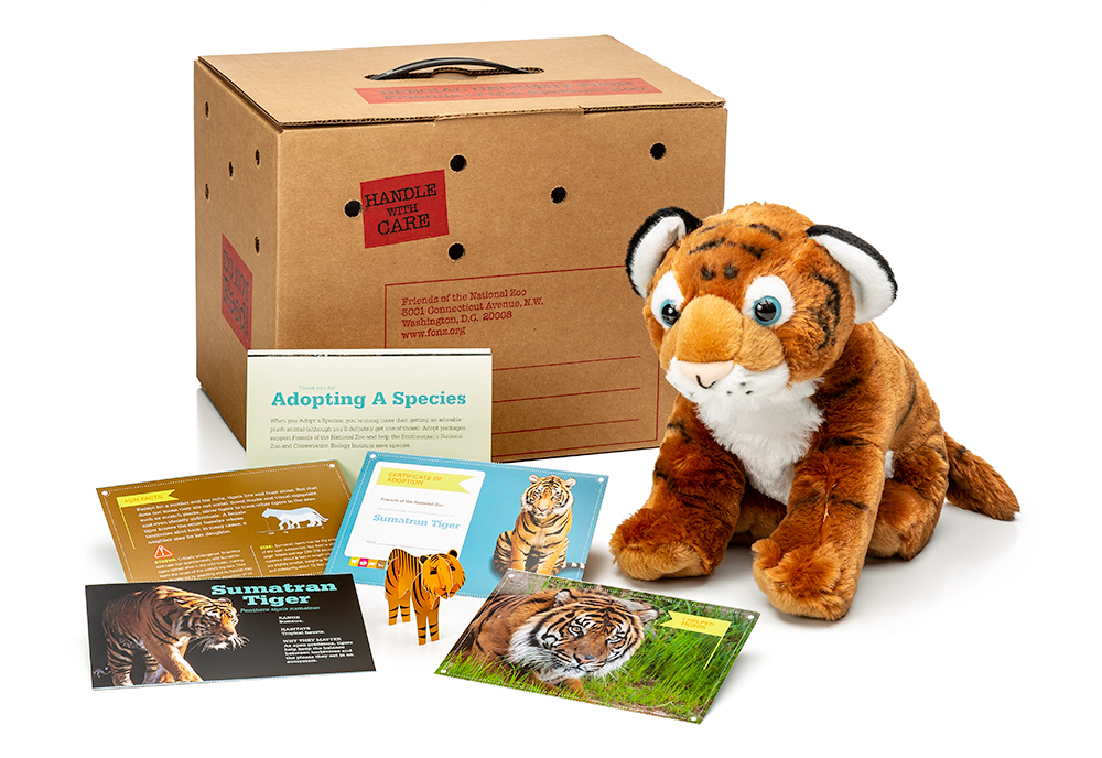 adopt a Sumatran tiger package featuring a plush, carrier box and photo-filled five card set