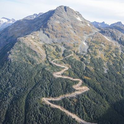 mountain from the air with road going up it