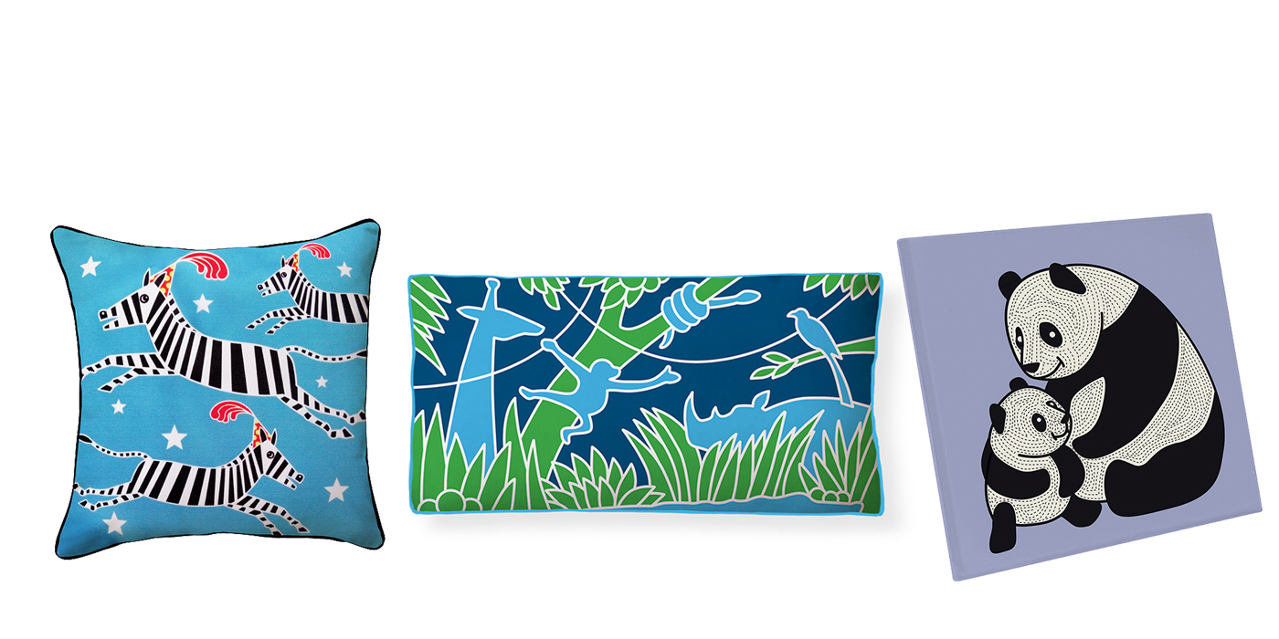 A zebra pillow, a jungle pillow and a panda coaster by local D.C. company Naked Decor