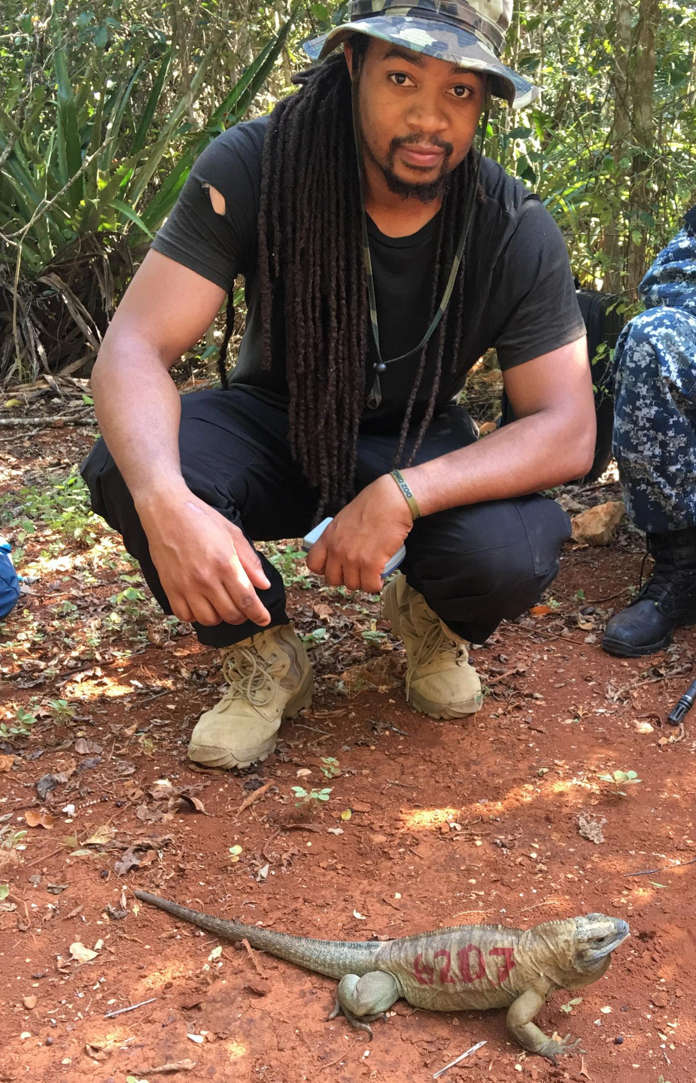 reptile discovery center keeper Kyle Miller participated in an iguana reintroduction program in Jamaica.