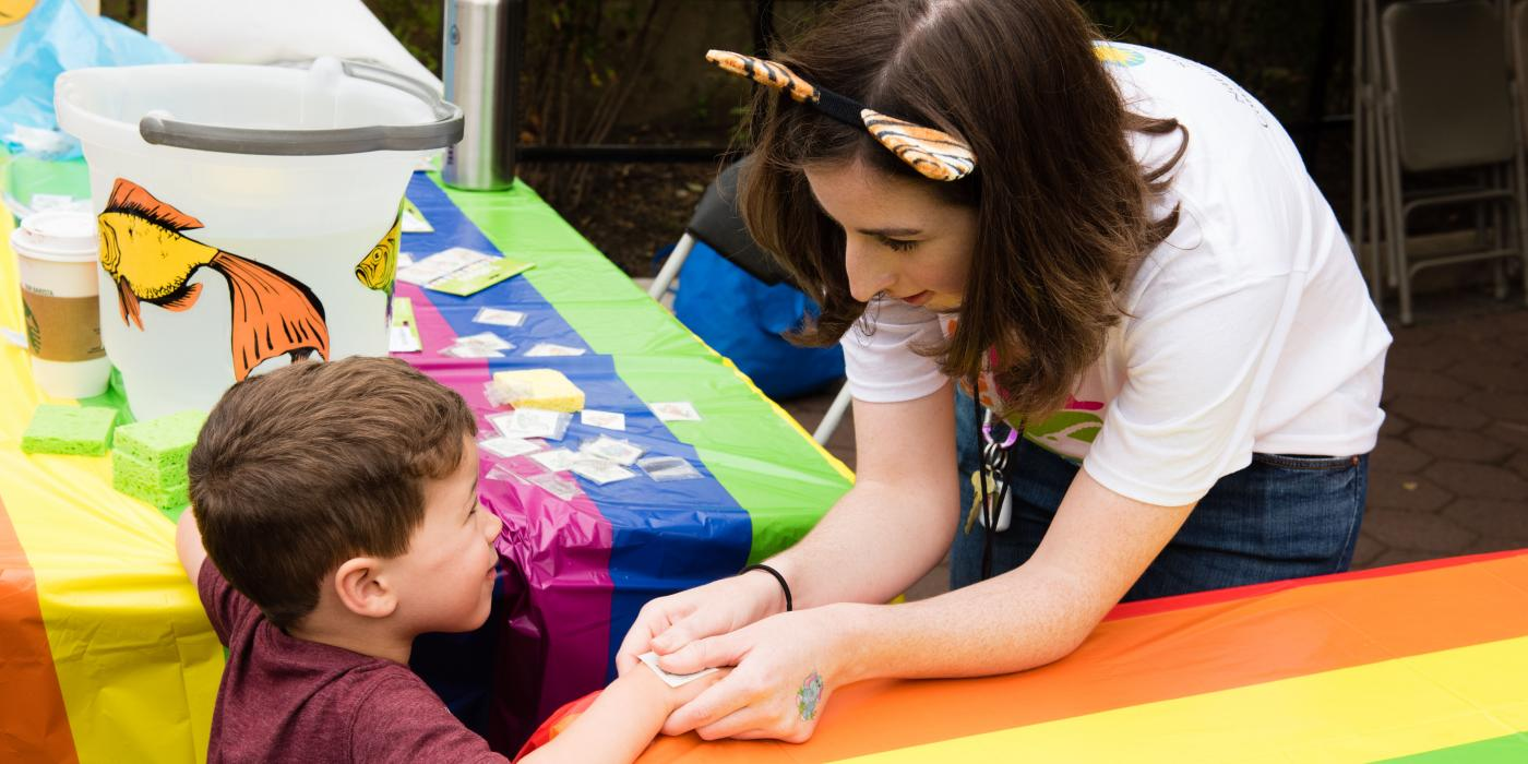 Zoo visitors receive temporary tattoos on International Family Equality Day.