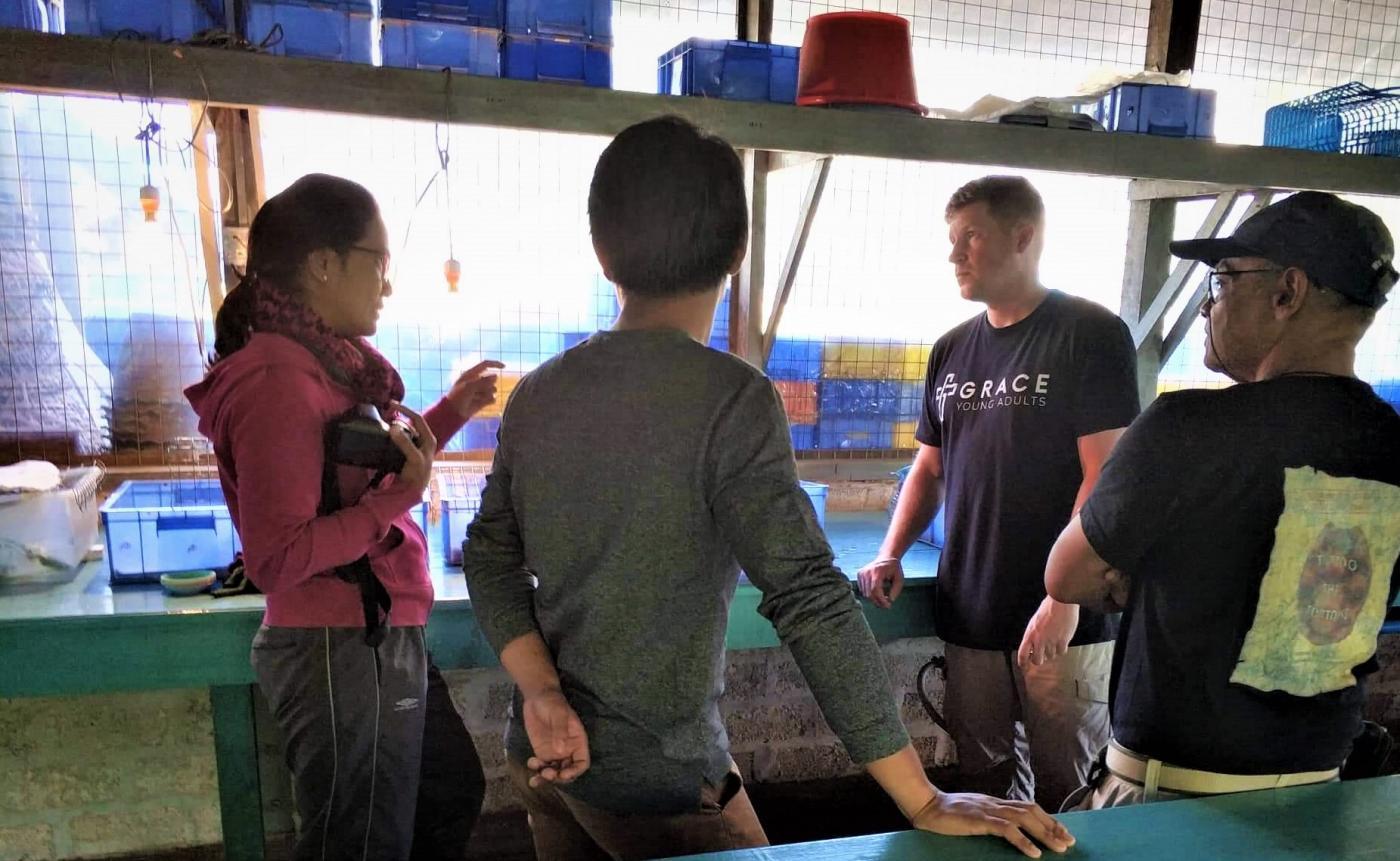 Matt Evans and colleagues in Myanmar discuss turtle husbandry.