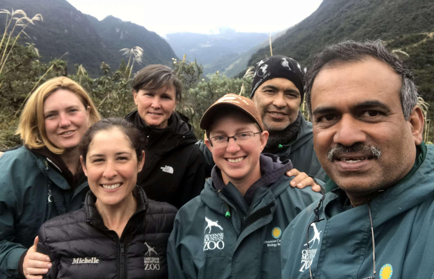 A group of six scientists pose for a photo in front of mountains during a tapir research expedition in Ecuador