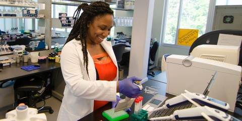 scientist pipetting
