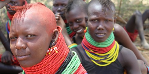 A group of Turkana girls in Kenya wearing brightly colored beaded necklaces