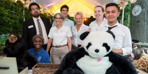 Volunteers pose for photo during ZooFari event