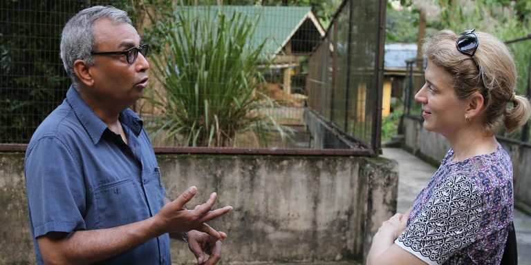 Smith talks with a colleague in India