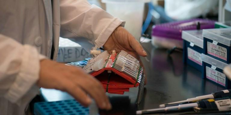 scientist holding vials