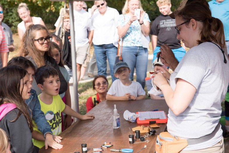 A bird-banding demonstration by Smithsonian Migratory Bird Center Scientists at Conservation Discovery Day.