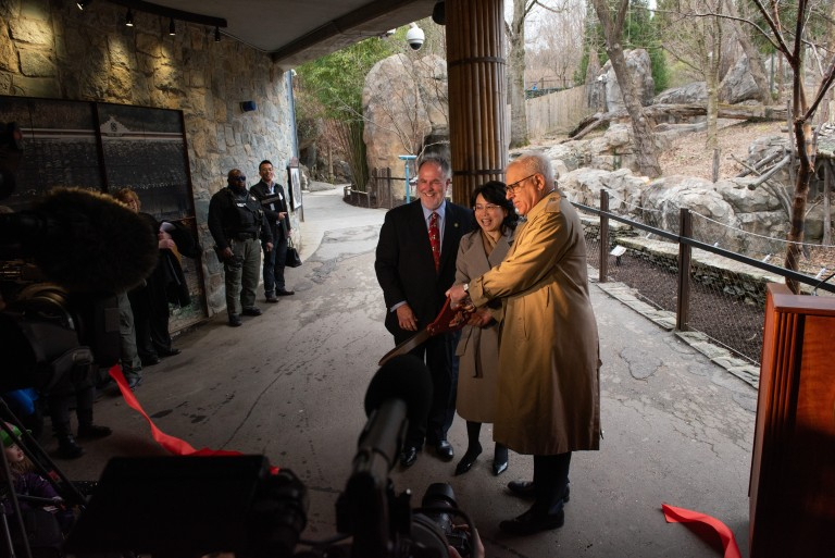 Director Steven Monfort, Minister Xu Xueyuan (Embassy of the People's Republic of China) and David Rubenstein cut a red ribbon during the Smithsonian's National Zoo's Giant Panda Housewarming Celebration