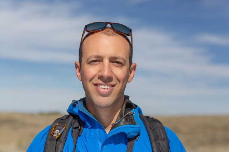 A head shot of ecologist Andy Boyce in the field at the American Prairie Reserve in Montana