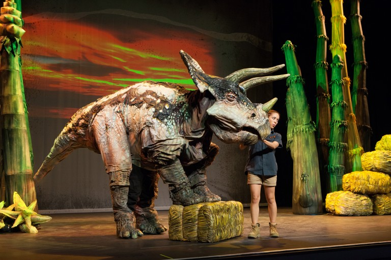 A life-sized triceratops on stage.