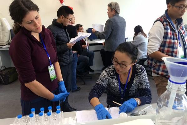 two female cientists look over data