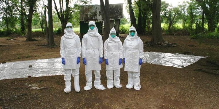 Scientists wearing biosecurity gear