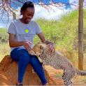 Global Health Program veterinarian Dr. Maureen Kamau and cheetah cub Pink.