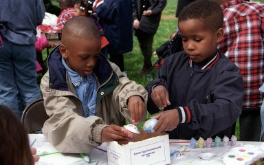 two boys decorating easter eggs