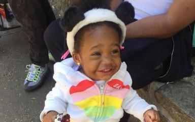 little girl wearing panda hoodie