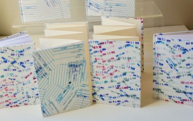 Four hand-bound books by local D.C. company Moonlight Bindery
