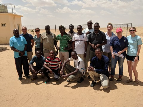 A group of students and teachers from a pathology workshop held in Chad pose together for a photo