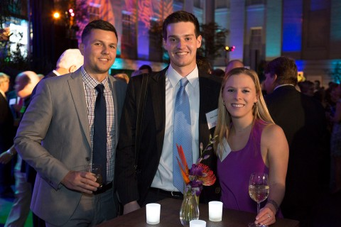 Two men and a woman pose for a photo at the Smithsonian's National Zoo's Monkey Business Gala