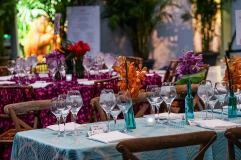 A table with linens, glasses and flowers at the Smithsonian's National Zoo's Monkey Business Gala