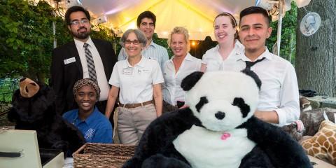 Volunteers pose for photo during ZooFari event