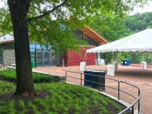The patio outside the Conservation Pavilion building at the Smithsonian's National Zoo. A large event tent is set up on the patio.