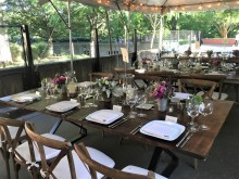 A table set for a meal with flower centerpieces at the Smithsonian's National Zoo's Great Cats exhibit