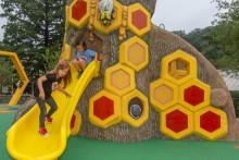 Children on slide at the Me and The Bee Playground