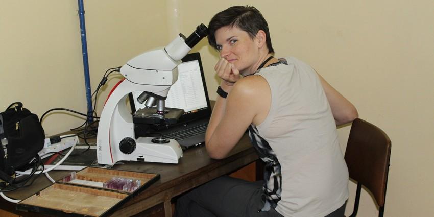 Dr. Kali Holder examines rhino histology slides in Nairobi, Kenya.