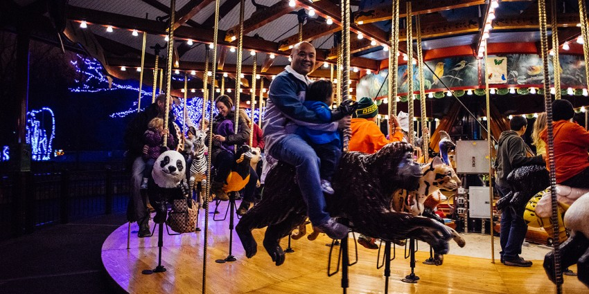 FONZ members on conservation carousel during ZooLights