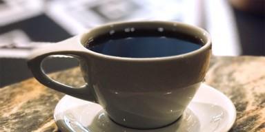 a mug of coffee on a saucer